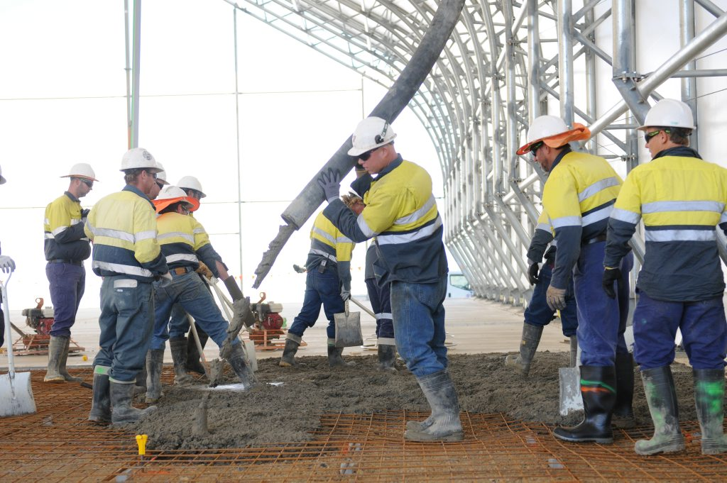 Concreters are hard at work at the QCLNG project on Curtis Island, Gladstone.