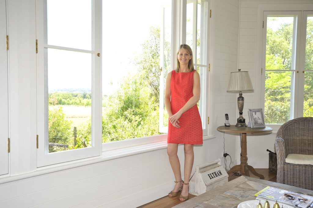 Jane Thomson at the window looking over Eltham Valley. Jane made sure the new windows are as close as possible to the original timber windows.