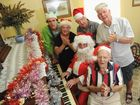 Bob Larter (foreground) rehearsing carols with Santa and his helpers Matthew Rollings, Janice Mash, Rex Einam and John Andersen ahead of the Hervey Bay Historical Village and Museum's Carols in the Village on December 1.