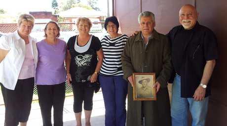 The war coat handover (L-R): Sharon Barrett, Laraine Vellozzi, Merrian Ross, Katina Comino, Peter Comino and John Comino.