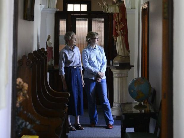Sisters of Mercy archivist Sr Judith Weiley with conservator Catheron Ackeroyd on a tour of the archives and rooms at the Sister of Mercy convent in Grafton - which a government grant will help preserve the artifacts in. Photo: Adam Hourigan / The Daily Examiner