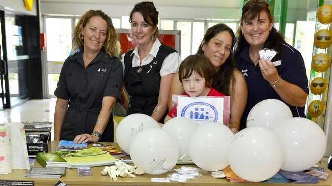 (L-R) Sallie Kearnan, Kim Bevan, Thomas Beard, 3, Natalia Muszkat and Debbie Flaherty were out in force promoting White Ribbon Day at Kin Kora Stockland. Photo Christopher Chan / The Observer