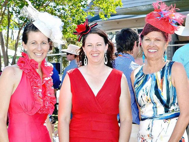 BRIGHT AND BEAUTIFUL: Suncorp's Michelle Chicken congratulates fashion winners Natalie Goodland from Theodore and Bronwyn Burnham from Eidsvold.