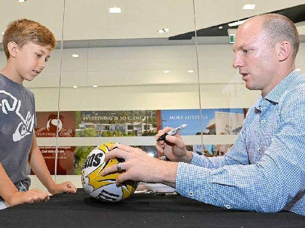 Lockyer signs Zach Grey's football yesterday.