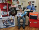Chronicle general manager Darren Bosley, editor Mat Nott and media advertising manager Leif Mikkelsen with just some of the goods to be won in the Chronicle's Christmas Stocking Shop Local competition.