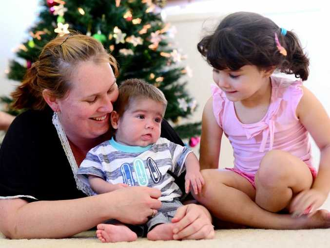 Happy family, Shanna Cook with children, Curtis Shore, 4 months, and Reagan Cook, 4 are excited to all be at home for christmas due to Curtis being ill in Brisbane.