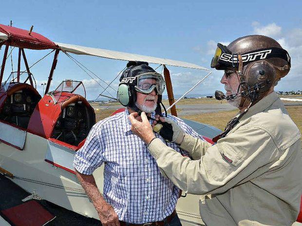 Laurie Neilsen (left) prepares for his Tiger Moth flight with pilot Greg Christensen.