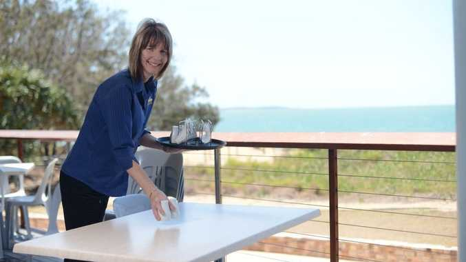 Marisa Kent is setting up at the Tannum Sands Surf Club to serve lunch and coffee.