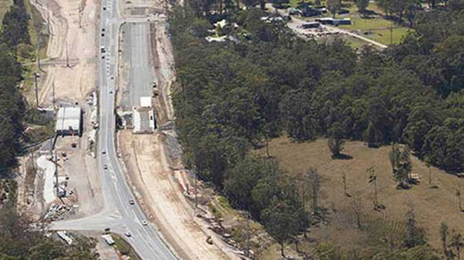 The Moonee Beach overpass will open to traffic in the next six months.