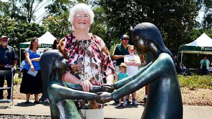 FOREVER YOUNG: Joan Busby, a relative of the famed but tragic Babies of Walloon, unveils the new Babies of Walloon statue.