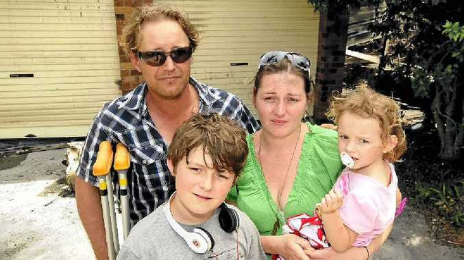 Despite their home being destroyed by fire, Tom Smith, Elicia Maxwell, Isabella Smith, 3, and Connor Smith, 11, feel lucky the family escaped unhurt.