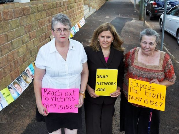 Child sex abuse campaigners (from left) Kathy Devine, Survivors Network of those Abused by Priests founder Barbara Blaine and Sylvia Tunley outside the Hume St office of the Department of Education.
