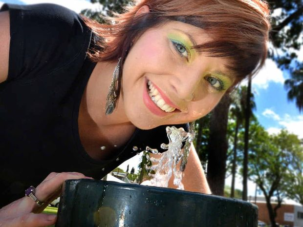Candice Jones has a drink in Memorial Park as the debate about fluoride in town water flares.