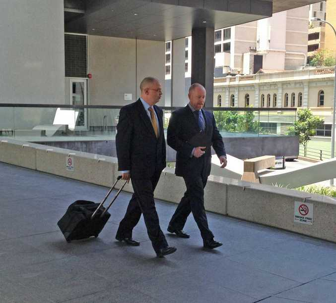Lawyers Michael Bosscher and Tim Meehan leave Brisbane Magistrates Court during the Daniel Morcombe murder committal hearing.