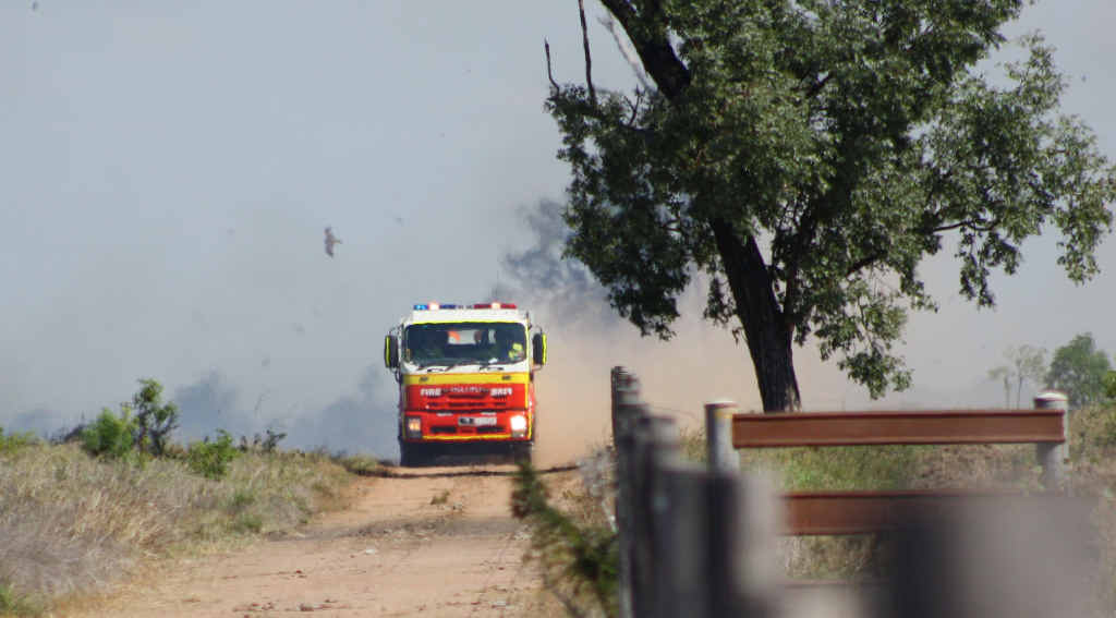 Firefighters work to contain a fire off Lochlees Rd, east of Emerald, on Monday afternoon.
