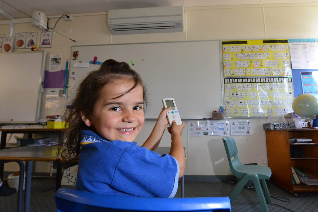 COOL BREEZE: Kalkie State School's Taya Bauer won't be raising a sweat when she is hard at work anymore thanks to Reuben Bauer's generosity of installing an air-con in a room every time he sells a house and land package.