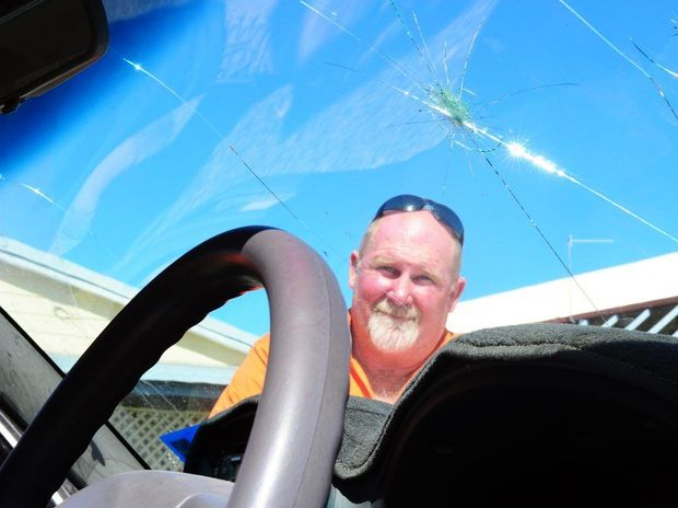 Dale Johnson is not happy with his damaged windscreen caused by a flying rock on Port Curtis Way.
