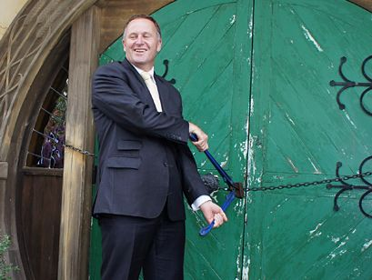 New Zealand PM John Key opens the new Green Dragon pub at Hobbiton.
