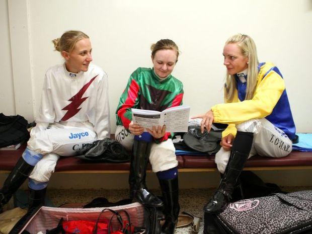Jockey's Carly-Mae Pye, Alexandra Kitson and Tracey O'Hara relaxing between races. Photo Allan Reinikka / The Morning Bulletin