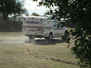 A man was shouting unintelligibly from the back of a police wagon after he was apprehended.