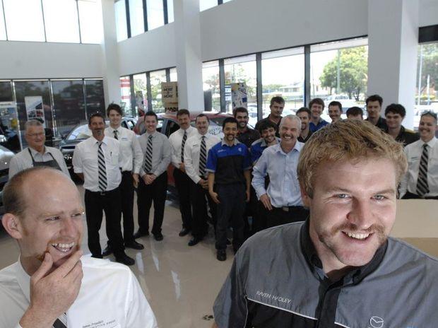 James Frizelles Motor Automotive Group sales person Phillip Filmer and workshop forman Raven Hadley compete in the comeptition for Movember with other members of staff at their offices in South Lismore. Photo Marc Stapelberg / The Northern Star