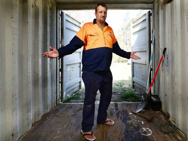 CUPBOARD BARE: Eastern Taipans Cricket Club president Brad Hines stands in the spot where two ride-on mowers were kept before being stolen.