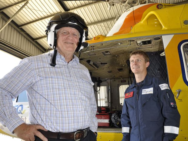 Chairman of the Order of St John organising committee Mike Horan (left) gets a tour of the CareFlight helicopter by chief crewman Brian Guthrie after presenting the service with a $50,000 donation.