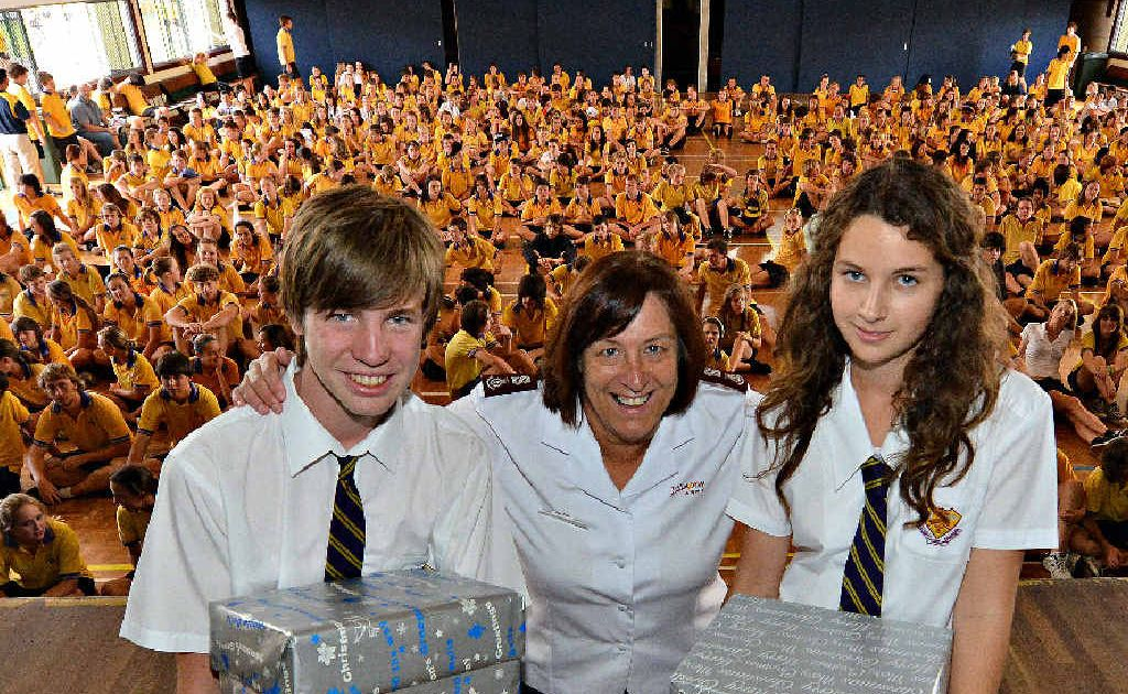 GREAT WORK: North Bundaberg High School's Jack Ford and Rachel Bridges present Christmas hampers to the Salvation Army's Major Heather Unicomb as part of the Mayor's Christmas appeal.