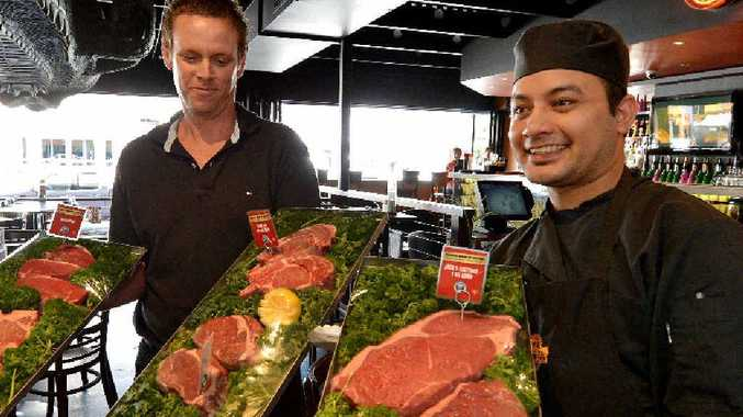 MEAT EATERS: Outback Jack's Bar & Grill owner Dean Beerhalter and chef Mukund Bista display some of the many types of steaks on the menu.