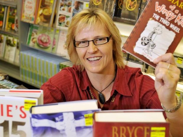 QBD The Bookshop manager Janelle Fyson with some of this Christmas's predicted top sellers.