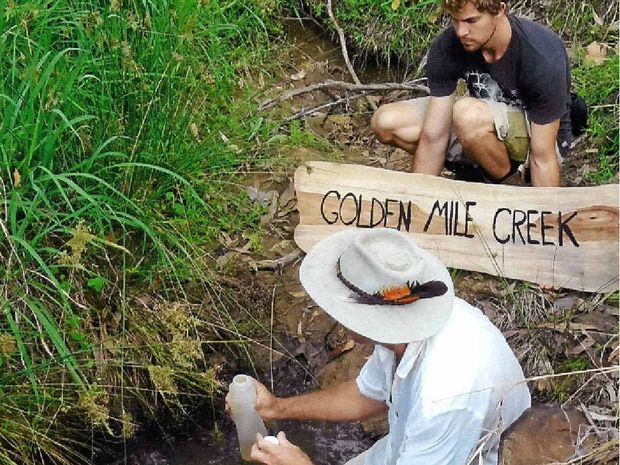 Glenugie community members taking water samples from a small creek near the site of a nearby gas well which is under construction.