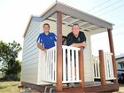 Gympie Apex's Sam Johnson and Gympie Combined Churches' Dean Comerford are ready for the combined Santa Fair and Carols by Candlelight where this cubbyhouse will be raffled.