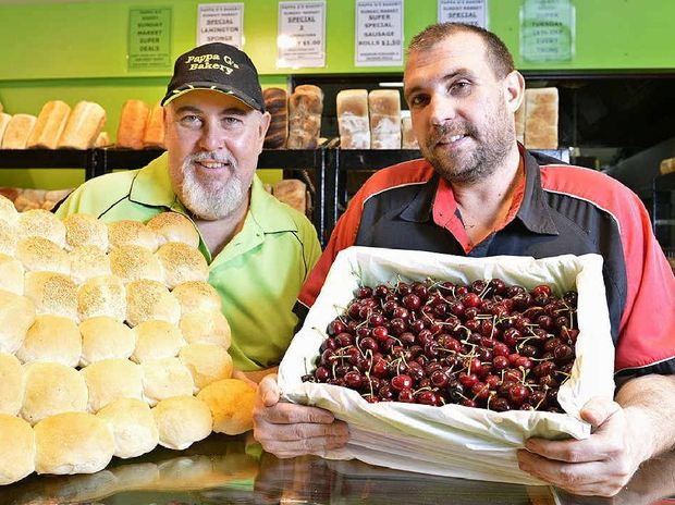 PARTY GIFTS: Graeme Creed from Pappa G's Bakery and Rob Sayle from Harvest Markets are donating food to the Ipswich Awakening Community Christmas lunch.