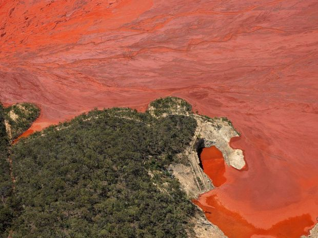 The refining process at QAL creates the toxic by-product 'red mud', which is stored in nearby dams (pictured). A gasket failure at QAL's refinery has caused waste material, which appears as a fine red spray, to disperse towards Sun Valley.