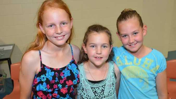 SPORTS NIGHT: Kathryn Kidman, Taylah Kidman and Bridget Madigan were among many junior athletes recognised at the South Burnett Primary School sports night at Kingaroy State School on Thursday.