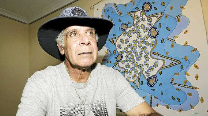 Artist Graeme Walker with one of his works Under the Micrscope at his new Exibition at the Jambana art gallery in Casino.