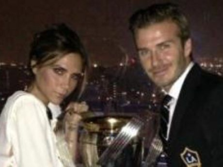 David and Victoria Beckham with MLS cup.