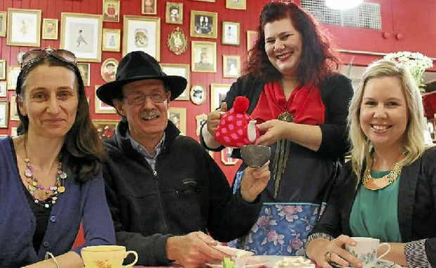 ART PARTY: Susanna Carpi, Stephen Nelson, Nadine Whitney and Katie O'Rourke celebrate the success of Lismore's Art in the Heart project with art and a cup of tea in Nadine's new shop in the Star Court Arcade.