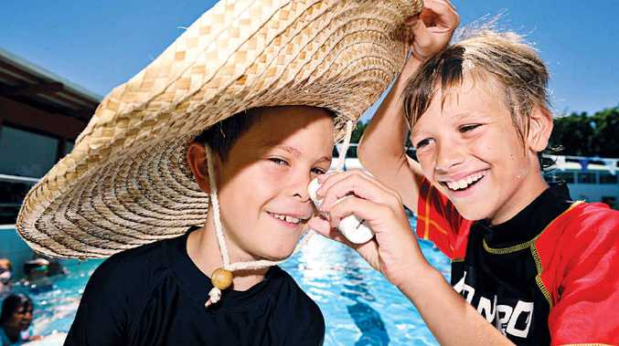 COVERING UP: Dashel Hunter, 8 left, and Manu Vandeveerdonk, 9, of Coffee Camp Public School are SunSmart during swimming lessons at the Lismore Memorial Baths.