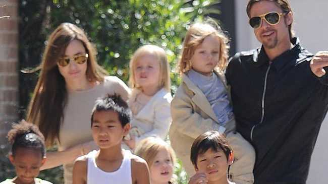 Angelina Jolie with Brad Pitt and their kids.