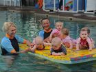 Elders Swim School instructors Leanne Lee and Dee Stubbs with young students.