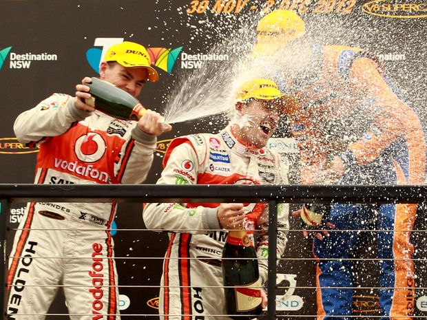 Jamie Whincup driver of the #1 Team Vodafone Holden celebrates winning the 2012 Championship after the Sydney 500, which is round 15 of the V8 Supercars Championship Series on December 2, 2012.  (Photo by Matt Blyth/Getty Images)