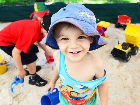 SANDY SUMMER: Finn Mulvogue enjoys the sandpit at the Goodna Community Centre.
