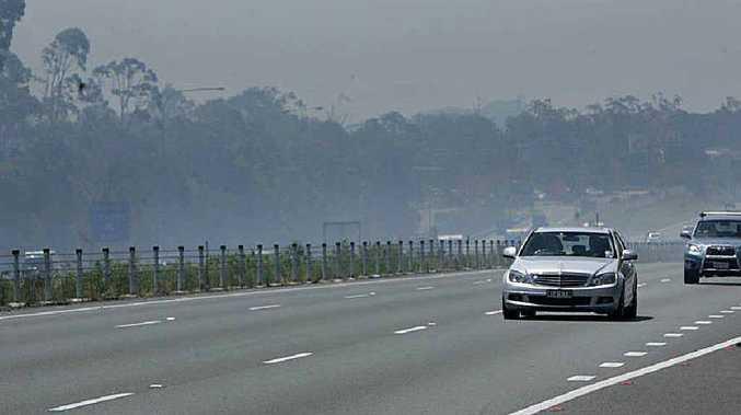 Smoke drifts across the highway.