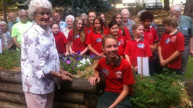 Dot Timmins of Goonellabah and Lismore South Public School captain Racquel Smith, 11, along with students and seniors who took in the Lismore City Council-funded Blooms that Bond project.