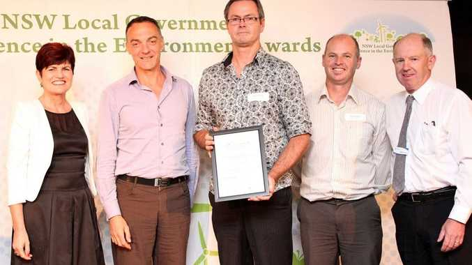 Minister for the Environment Robyn Parker presents the Local Government Excellence in the Environment Award to Lismore City Council's ecologist, Damian Licari; integrated strategic planner, Steve Denize; environmental strategies coordinator, Nick Stephens; and Bernie Bugden from Hawkesbury Nepean Catchment Management Authority.