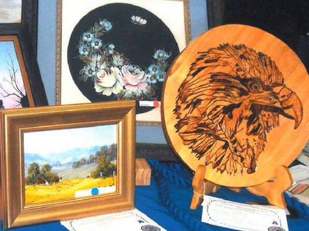 FLYING HIGH: Successful painting and woodturning entries in the handcraft display at the recent QCWA state conference at Toowoomba.