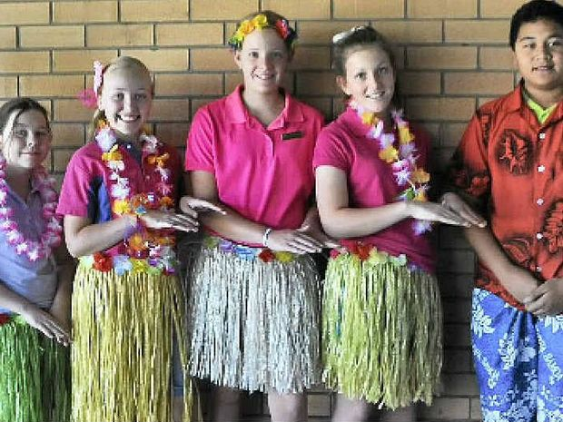 ISLAND THEMED FUNDRAISER: Students Kate Jordan, Maddie Farrell, Eliza McLennan, Kaitlin Wallace and Augustine Stowers with teacher Catherine Lutvey, who is off to Samoa.