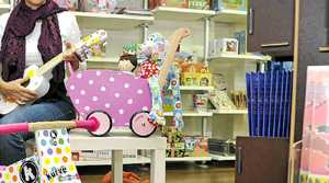 JOYOUS: Monica Martignoni of Alstonville at Toy Kingdom looks for Christmas presents for her children that are of good quality while Hollie James (opposite page, inset), Manager of Toy Kingdom with some of the old fashioned toys they stock in store.