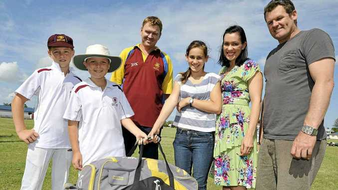 TEAM WORK: Tintenbar-East Ballina Cricket club members, from left, Bailey Crawford, 11, Oscar Smith, 10, and Brett Crawford, hand over cricket gear their members have donated to Kate Morgan and her family, daughter Bella, 12, and husband Paul pictured, to give to their Sri Lankan sponsor child Andru when they visit him this Christmas.
